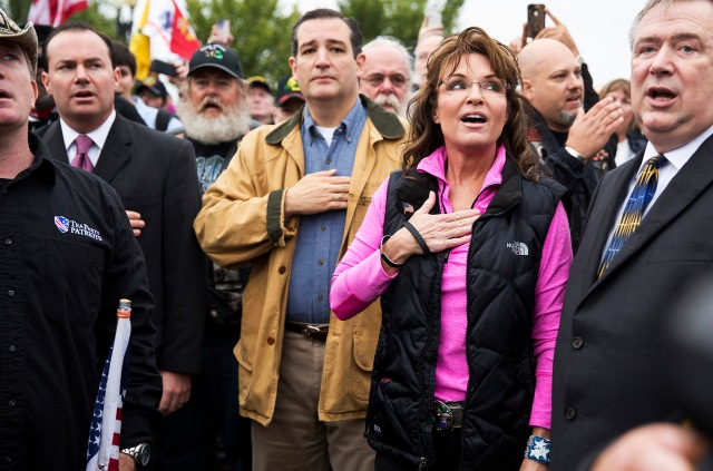 "Former Alaska Governor Palin and Senator Cruz recite Pledge of Allegiance during ""Million Vet March on the Memorials"" at U.S. National World War II Memorial in Washington"